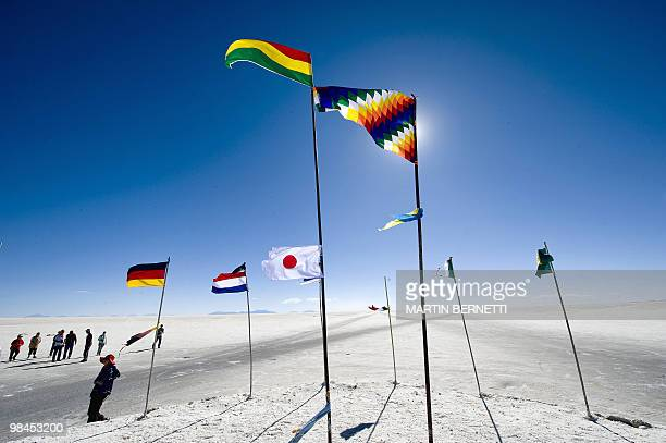 Flags from numerous countries are seen waving at the Uyuni salt flats Bolivia on October 9 2009 The Uyuni salt flats are estimated to contain 10...