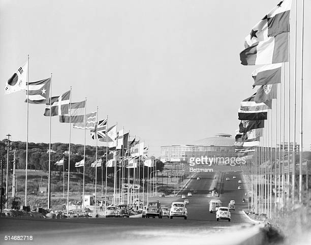 Flags from the nations participating in the 1960 Olympics wave from poles along the Via Olympica in Rome The wide avenue leads to the Olympic Sports...