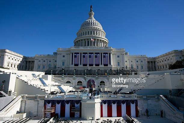 Flags hang from the US Capitol prior to the second inauguration of US President Barack Obama in Washington DC US on Friday Jan 18 2013 President...