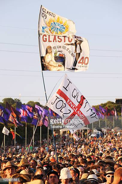 Flags held aloft to mark the 40th Glastonbury Festival are spotted in the crowd as festival goers enjoy watching Dizzee Rascal on the Pyramid stage...