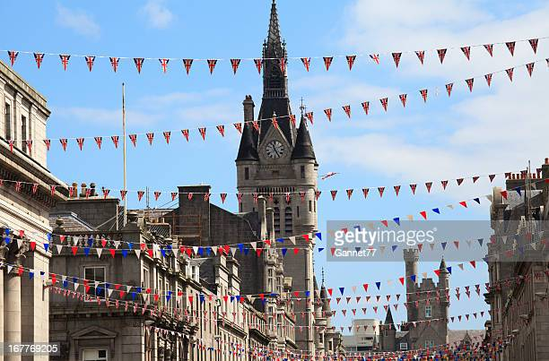flags hung on union street in aberdeen  - grampian scotland stock pictures, royalty-free photos & images