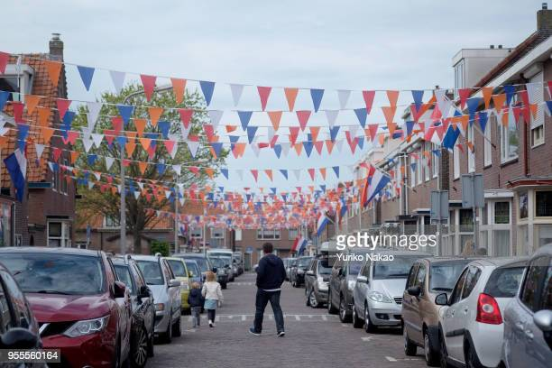 Flags in Dutch national colors are put up outside houses to celebrate the Koningsdag or the King's day April 27 in Katwijk, Netherlands. King's day...
