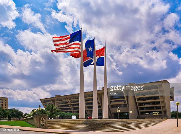 flags in front of Dallas City Hall