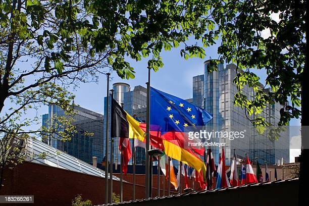 flags in front of european parliament, brussels - brussels capital region stock pictures, royalty-free photos & images