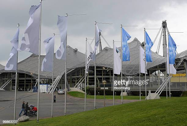 Flags in front of the Olympia Hall site of the Bayerische Motorenwerke shareholders' meeting in Munich Germany on Tuesday May 18 2010 Bayerische...