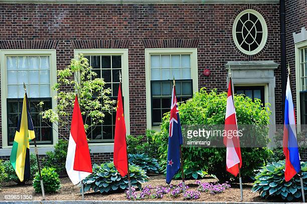 flags in loomis chaffee school campus - boarding school stock photos and pictures