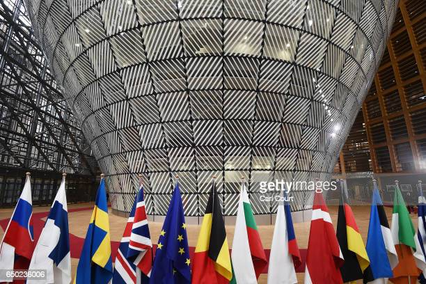 Flags in the arrival area of the Europa building at the Council of the European Union on the first day of an EU summit on March 9 2017 in Brussels...