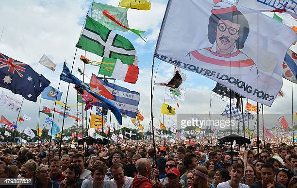 Flags in the crowd prior to Lionel Richie's performance on the Pyramid stage during the third day of Glastonbury Festival at Worthy Farm Pilton on...