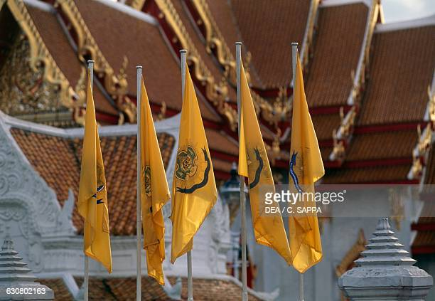 Flags in the Marble temple or Wat Benchamabophit Dusitvanaram Bangkok Thailand 20th century