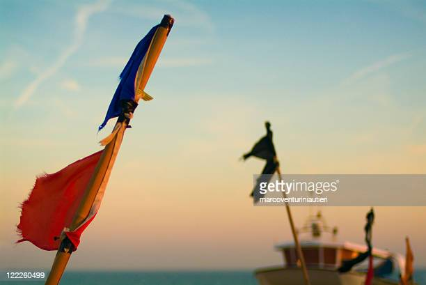flags in the wind - hastings stock photos and pictures