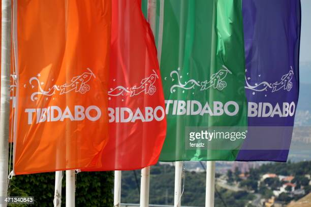 flags in tibidabo - tibidabo stock pictures, royalty-free photos & images