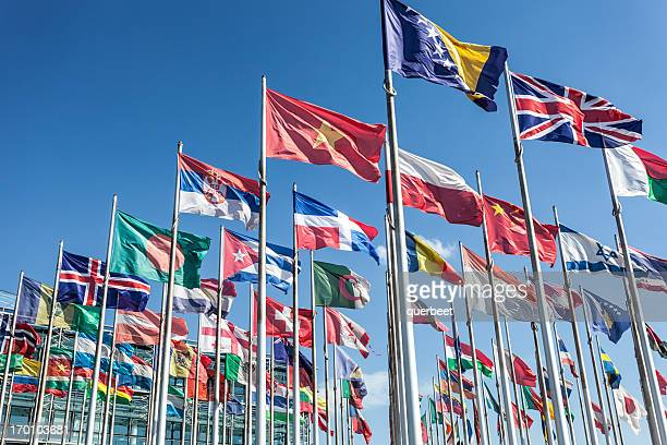 flags in wind - flags of the world stock photos and pictures