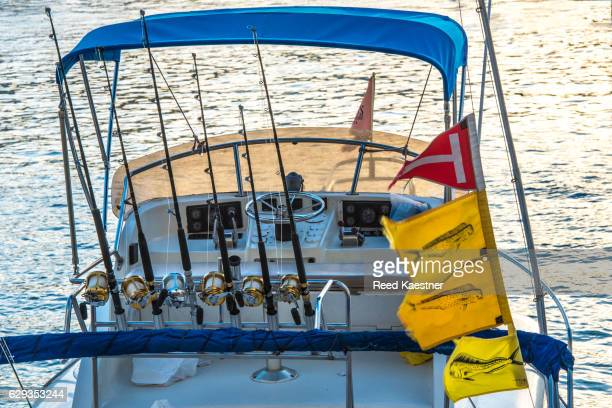 Flags indicate fish that were caught on boats in the harbor of Cabo San Lucas.