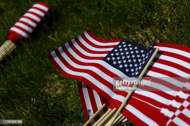 Flags lay in the grass outside of Gillette Stadium on May 21 2020 in Foxborough Massachusetts The Patriots foundation partnered with the...