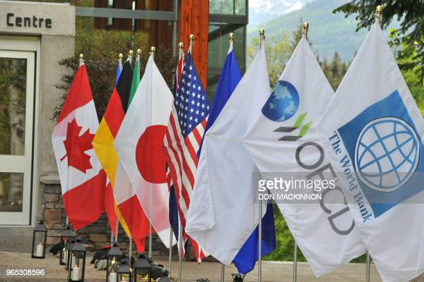 Flags line the entrance on May 31 2018 at the Squamish Lil' wat Cultural Centre where the delegates of G7 Finance Ministers and Central Bank...