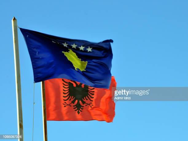 flags of albania and kosovo - kosovo stock pictures, royalty-free photos & images
