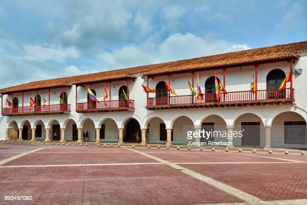"flags of Cartagena at historical facade of town hall ""Alcaldia Mayor"""