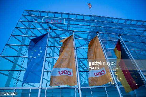 Flags of CDU stand next to the headquarters of the German Christian Democrats CDU at twilight on February 12 2020 in Berlin Germany The CDU will seek...