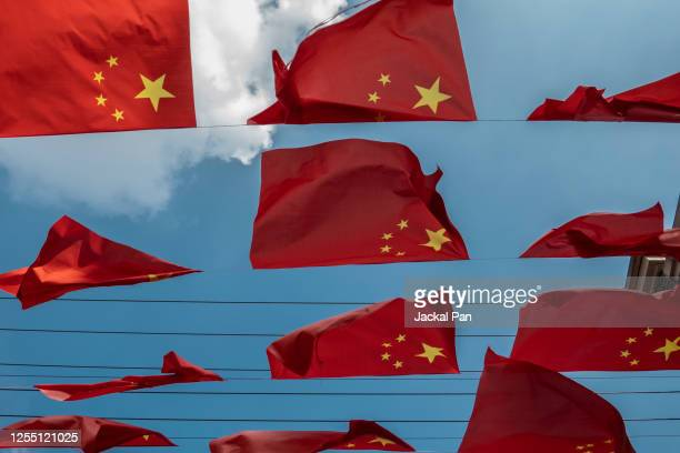 flags of china - patriotism stock pictures, royalty-free photos & images