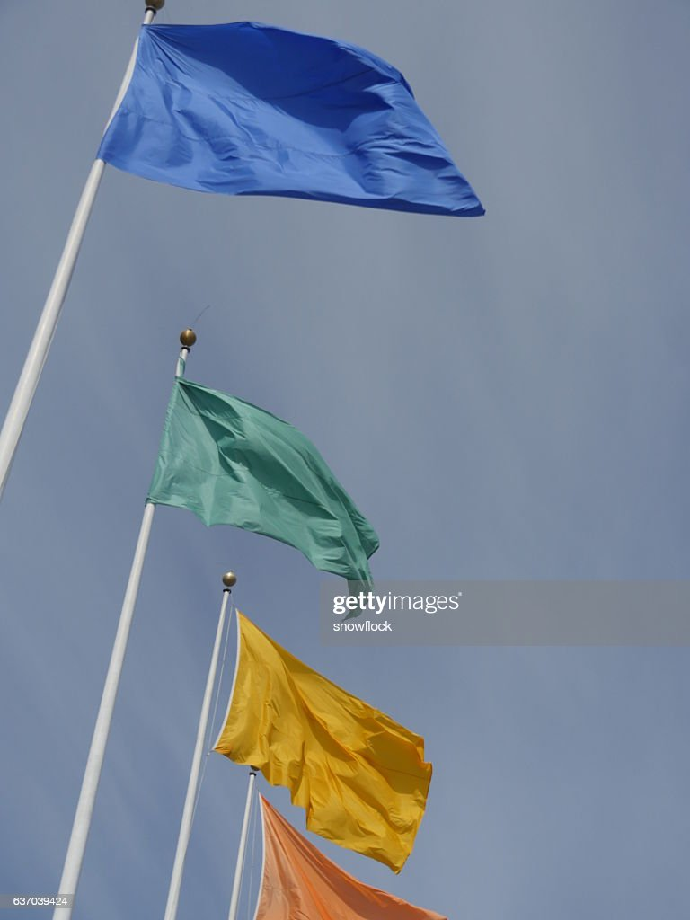 Flags Of Different Colors On Flagpoles Stock Photo - Getty Images