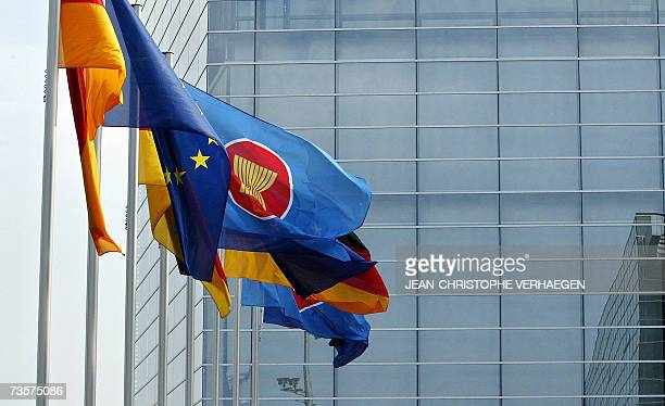Flags of EU and ASEAN members wave in front of Nuremberg's congress center where takes place an EUASEAN summit 14 March 2007 in Nuremberg southern...