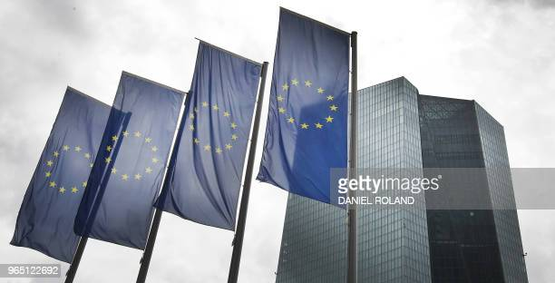 Flags of Europe flutter in front of the headquarters of the European Central Bank in Frankfurt am Main western Germany on June 1 2018