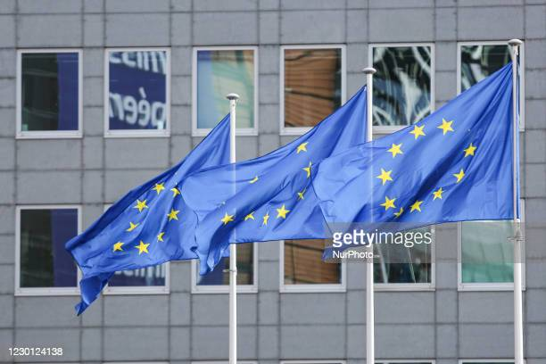 Flags of Europe waving as seen on a pole. The European Flag is the symbol of Council of Europe COE and the European Union EU as seen in the Belgian...