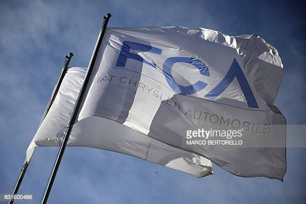 Flags of Fiat Chrysler Automobiles fly in the wind at the Fiat Mirafiori car plant on January 13 2017 in Turin northern Italy The United States on...