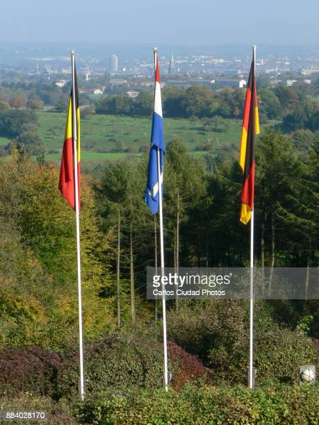 Flags of Germany, Netherlands and Belgium in the tripoint of Vaalsburg