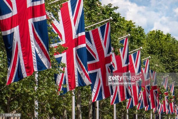 flags of great britain in a row along pall mall in london, united kingdom - diplomacy stock pictures, royalty-free photos & images