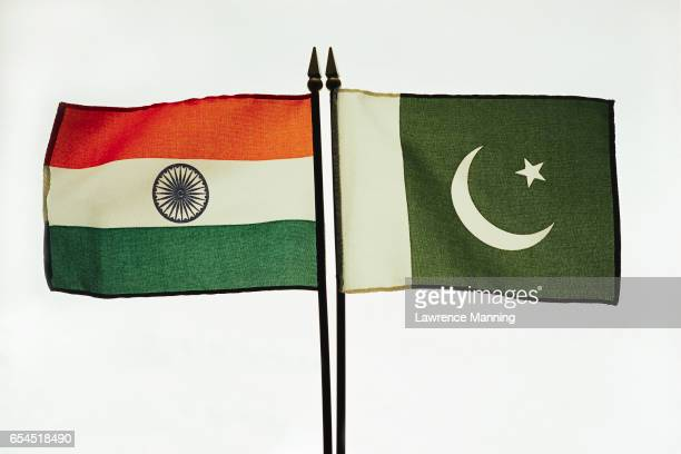 flags of india and pakistan - pakistani flag stock photos and pictures