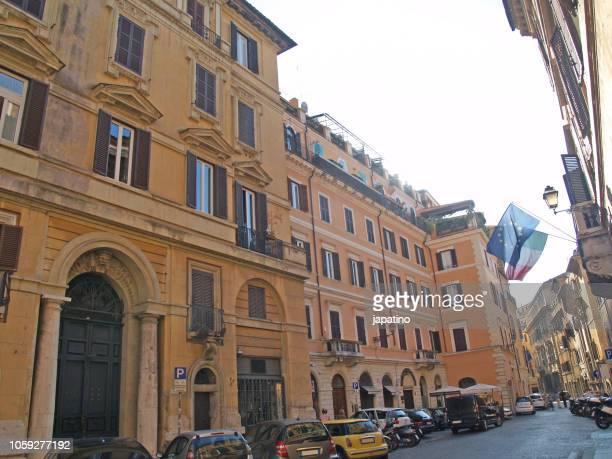 Flags of Italy and the European Union. Streets of the historical center of the city of Rome