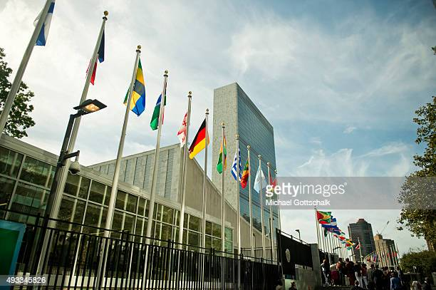 Flags of member nations in front of United Nations headquarters on September 25 2015 in New York United States