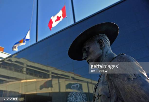 Flags of Nova Scotia and Canada fly at halfstaff outside the Nova Scotia Royal Canadian Mounted Police headquarters in Dartmouth Nova Scotia Canada...