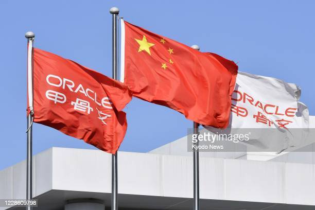 Flags of Oracle Corp. Are flown together with China's national flag at the U.S. Software company's office in Beijing on Sept. 18, 2020.