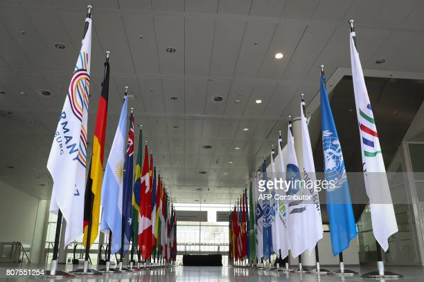 Flags of participating countries and organisations stand on July 4 2017 at the foyer of the Messehallen convention centre in Hamburg northern Germany...
