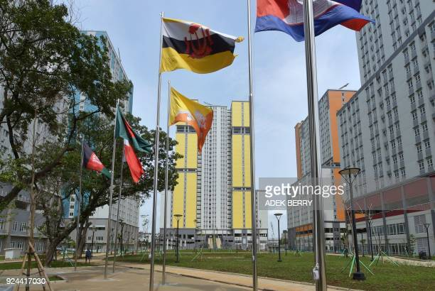Flags of participating countries at the 2018 Asian Games flutter at the athlete village in Kemayoran district, in central Jakarta on February 26,...