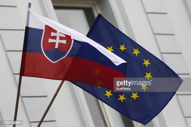 Flags of Slovakia and European Union are seen in Trnava on the day of parliamentary election in Slovakia on February 29, 2020.