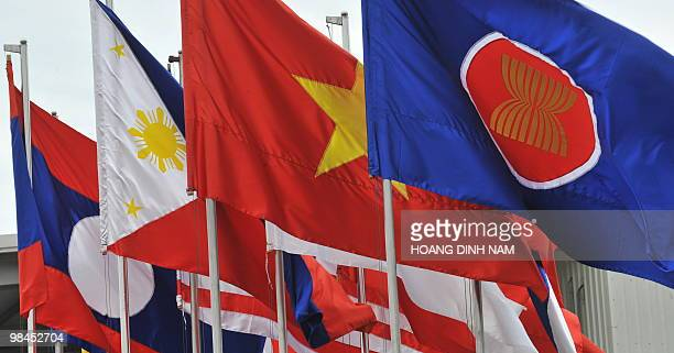Flags of Southeast Asian Nations are seen flying at Hanoi's Noi Bai international airport where ASEAN leaders keep arriving to attend the 16th summit...