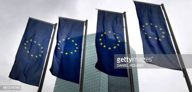 Flags of the European Union are displayed outside the headquarter of the European Central Bank in Frankfurt am Main western Germany on July 20 2015...