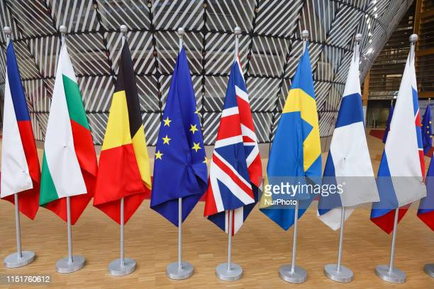 Flags of the European Union EU and the United Kingdom UK among other European flags in Europa Building in Brussels Belgium during the European...
