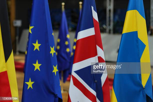 Flags of the European Union EU and the United Kingdom UK / Great Britain among all the other European flags in Forum Europa Building in Brussels,...