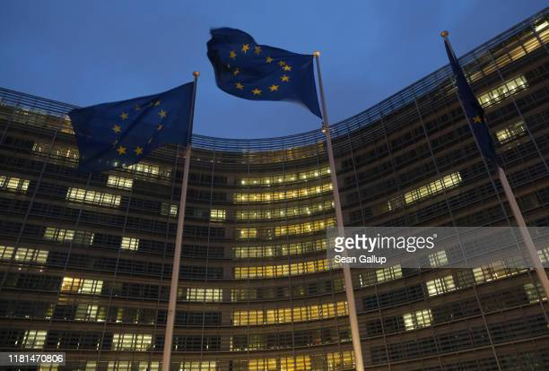 Flags of the European Union fly outside the Berlaymont building of the European Commission where EU and British negotiators met throughout the day...
