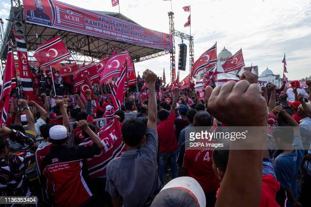 Flags of the Free Aceh Movement or the moon flags of flying stars seen with supporters during the Party campaign Aceh held a Party campaign for the...