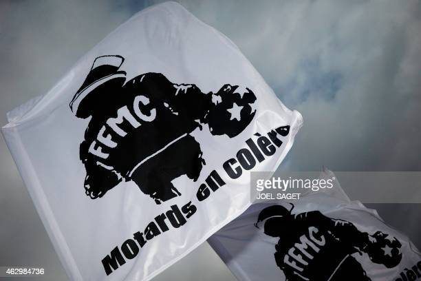 Flags of the French Federation of Angry Bikers are pictured as several hundred bikers gather for a protest ride in Paris on February 8 against the...
