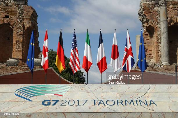 Flags of the G7 group of nations as well as the flag of the European Union stand on a stage in the ancient amphiteater prior to the beginning of the...