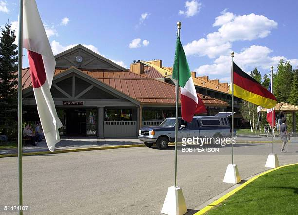 Flags of the Group of Eight economic nations fly near the center of Kananaskis Alberta Canada 22 June 2002 as preparations continue for the opening...