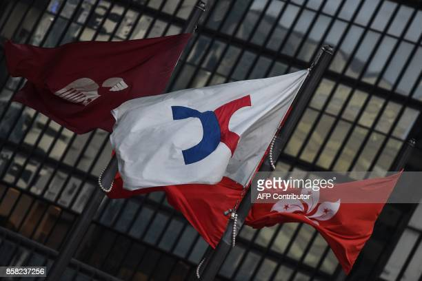 Flags of the Hong Kong Stock Exchange and Hong Kong are seen at Exchange Square after the Hang Seng Index closed up by 03 per cent at 2845804 its...