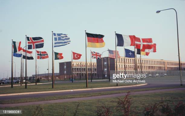 Flags of the member states flying before the NATO headquarters Brussels, Belgium, circa 1970. Among the flags of the North Atlantic Treaty...