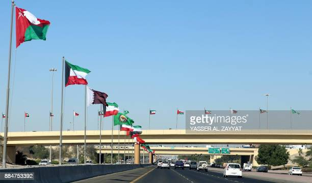 Flags of the member states of the Gulf Cooperation Council are seen on a highway in Kuwait City on December 3 2017 / AFP PHOTO / Yasser AlZayyat